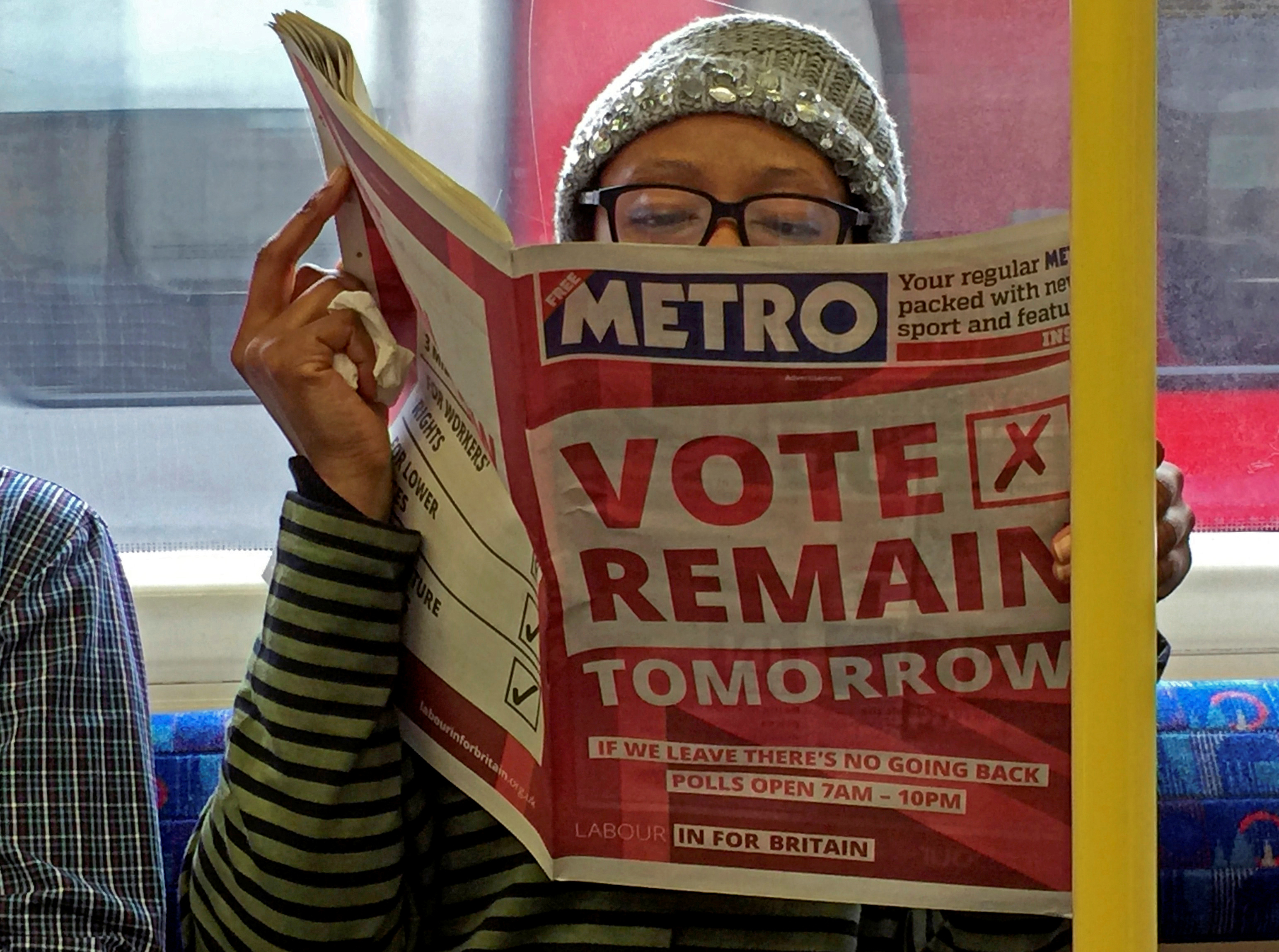 A woman reads a newspaper in London during the EU referendum campaign. REUTERS/Russell Boyce