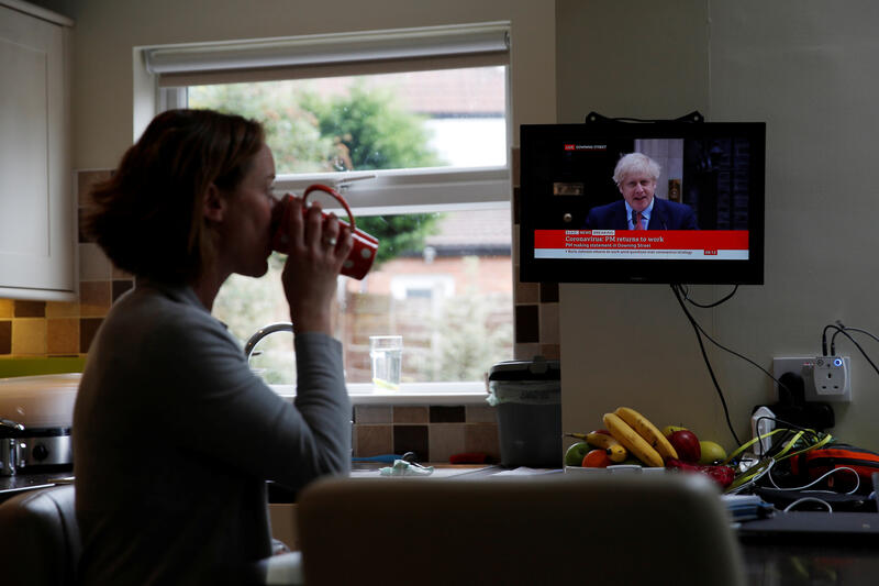 Woman watching BBC news