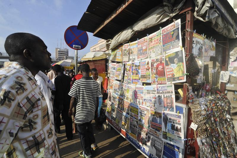 Man looks at news stand REUTERS/Yaw Bibini