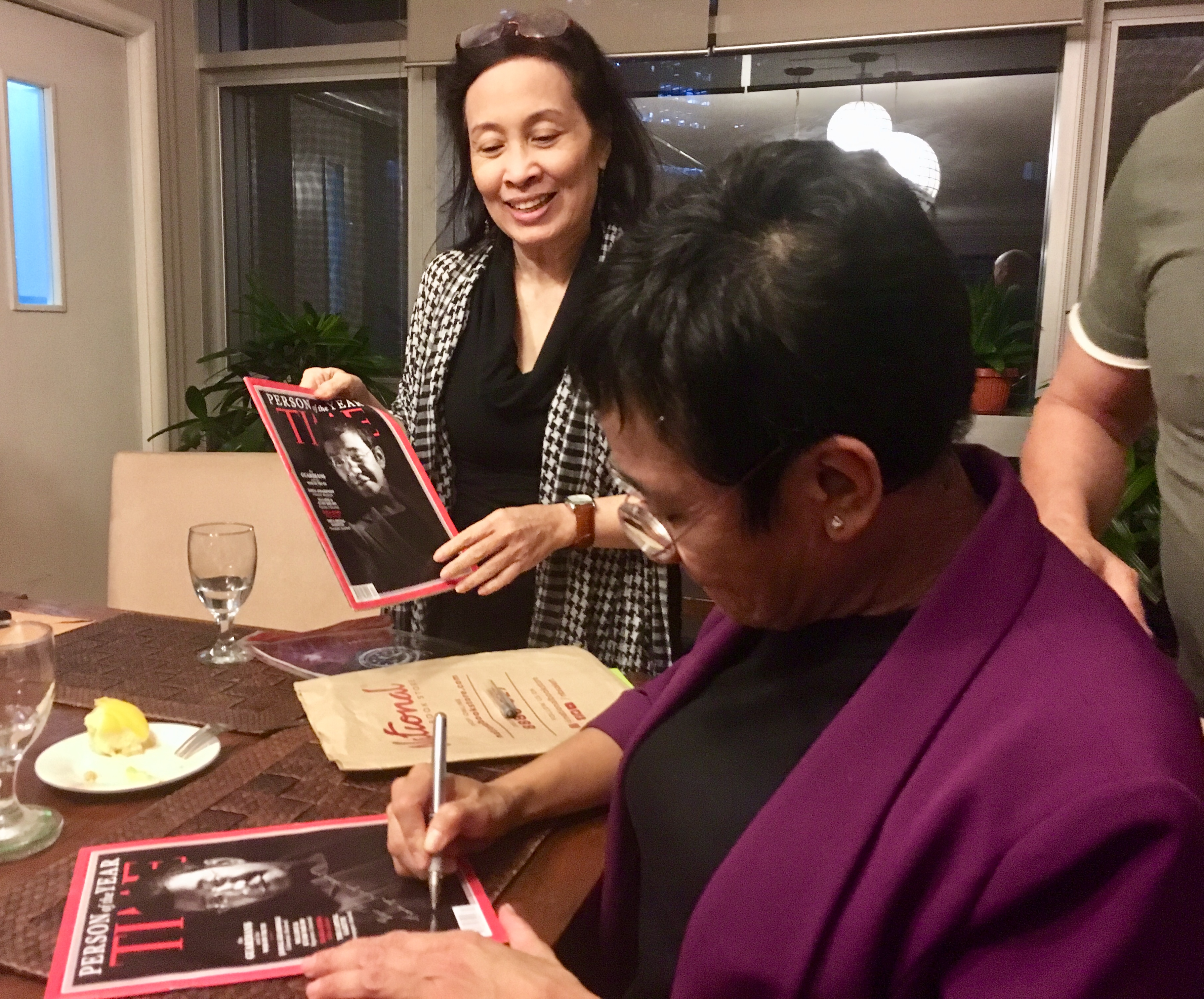 Maria Ressa signs Time Magazine edition