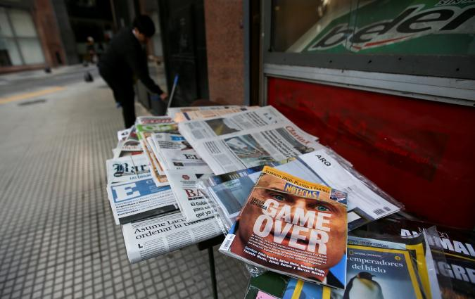 A magazine with the image of Argentine President Mauricio Macri is seen at a newspaper stand, in Buenos Aires. REUTERS/Agustin Marcarian