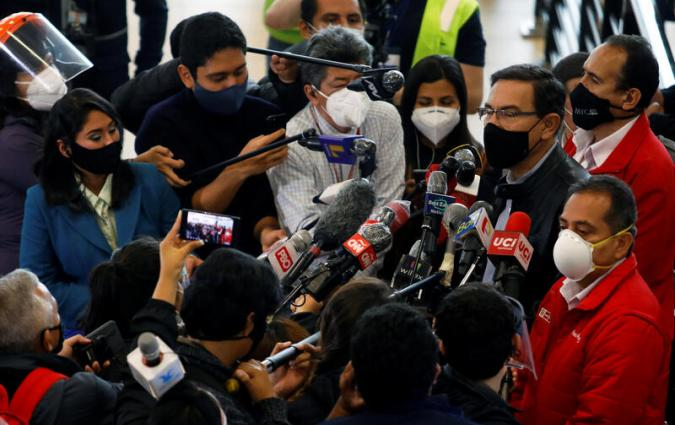 Peru's President Martin Vizcarra talks with journalists at the Jorge Chavez International Airport on its re-opening day for regular international commercial traffic after more than six months of lockdown following the coronavirus disease (COVID-19) outbreak, in Lima, Peru, October 5, 2020. REUTERS/Sebastian Castaneda
